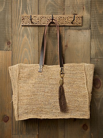 Straw & Leather Tassle Tote from freepeople.com